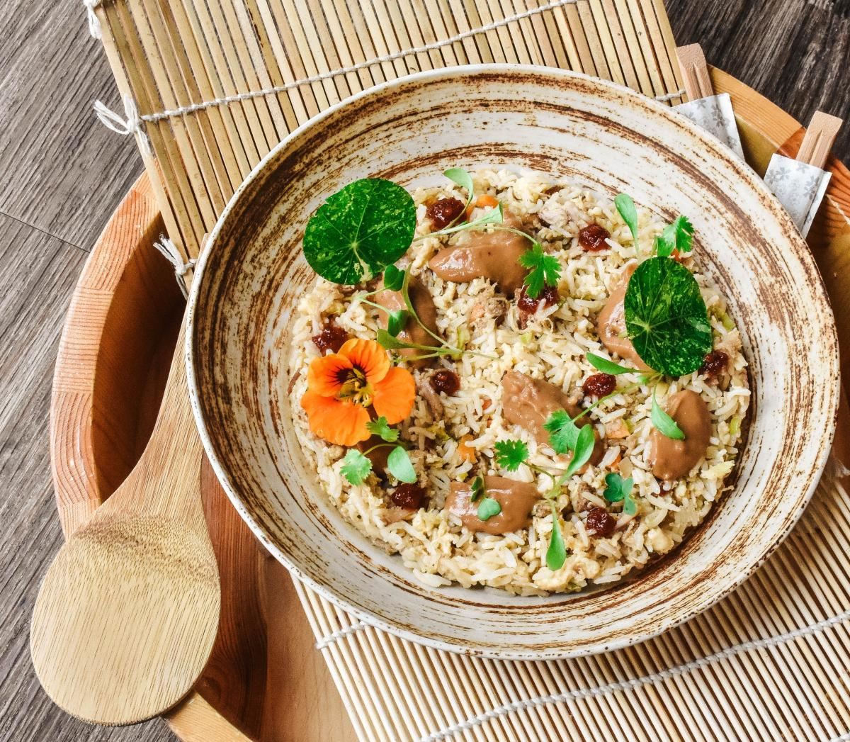 ceramic bowl with fried rice and vegetables